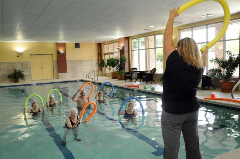 The Oaks at Bartlett | Residents swimming with pool noodles