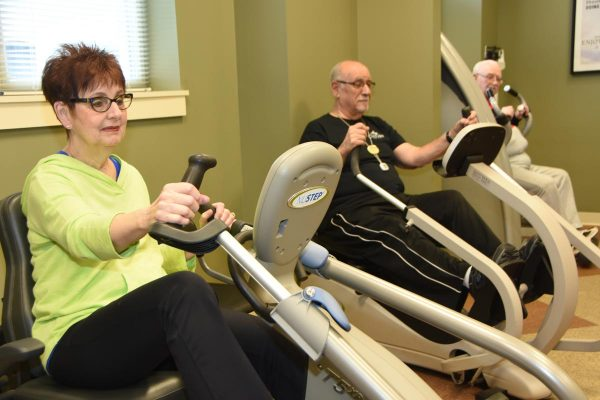 The Oaks at Bartlett | Residents riding indoor bikes
